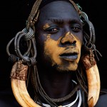 098-FACES-AFRICA-ETHIOPIA-OMO.VALLEY-Mursi.warrior